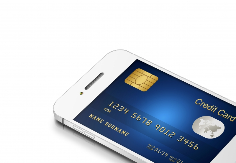 9778172-credit-card-with-mobile-phone-isolated-on-white